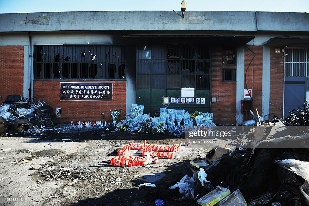 Debis sits outside a burned clothing factory after a fire where seven Chinese workers were burned to death on December 4, 2013 in Prato, Italy. Seven people died and three were injured December 1, when a Chinese clothing factory in the industrial district of the Italian town of Prato in Tuscany burned, killing the workers trapped in a factory dormitory, where workers sleep, eat, and work.