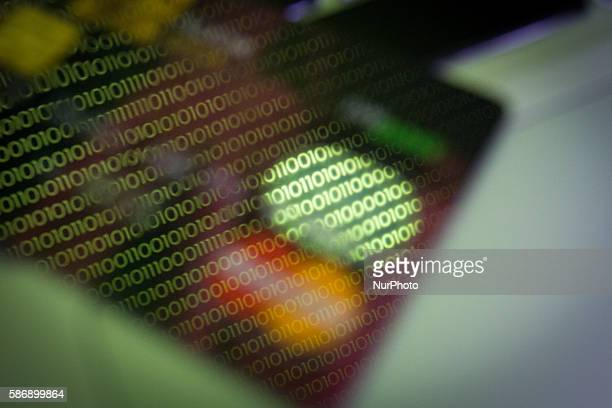 A debit card is seen on a laptop computer keyboard with binary numbers reflected in its hologram in Bydgoszcs Poland on August 7 2016