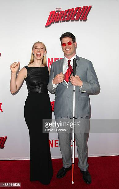 Deborah Ann Woll and EJ Scott attend the premiere of Netflix's 'Marvel's Daredevil' at Regal Cinemas LA Live on April 2 2015 in Los Angeles California