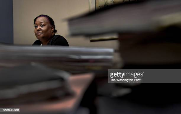 Deborah Bryant in her attorney's office in Washington DC She's framed by some of the thousands of pages of bound legal documents that are a part of...