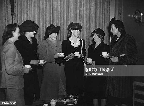 Deborah Cavendish the Dowager Duchess of Devonshire chatting to a group of South African war brides at Victoria League Hospital in Cromwell Road west...