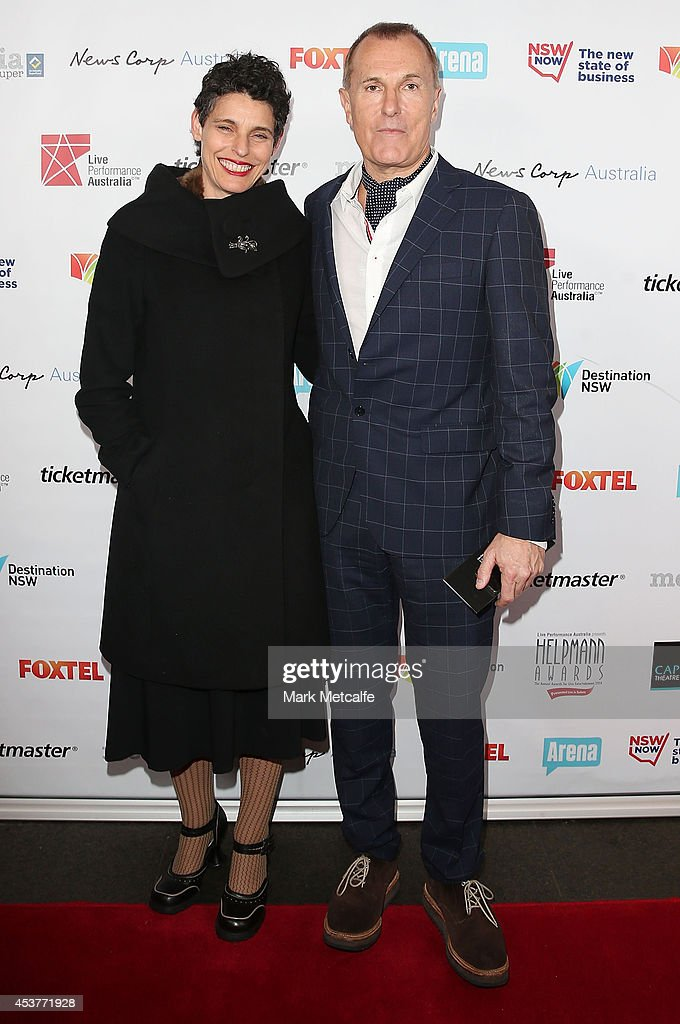 Deborah Conway and <a gi-track='captionPersonalityLinkClicked' href=/galleries/search?phrase=James+Reyne&family=editorial&specificpeople=2496350 ng-click='$event.stopPropagation()'>James Reyne</a> arrive at the 2014 Helpmann Awards at the Capitol Theatre on August 18, 2014 in Sydney, Australia.