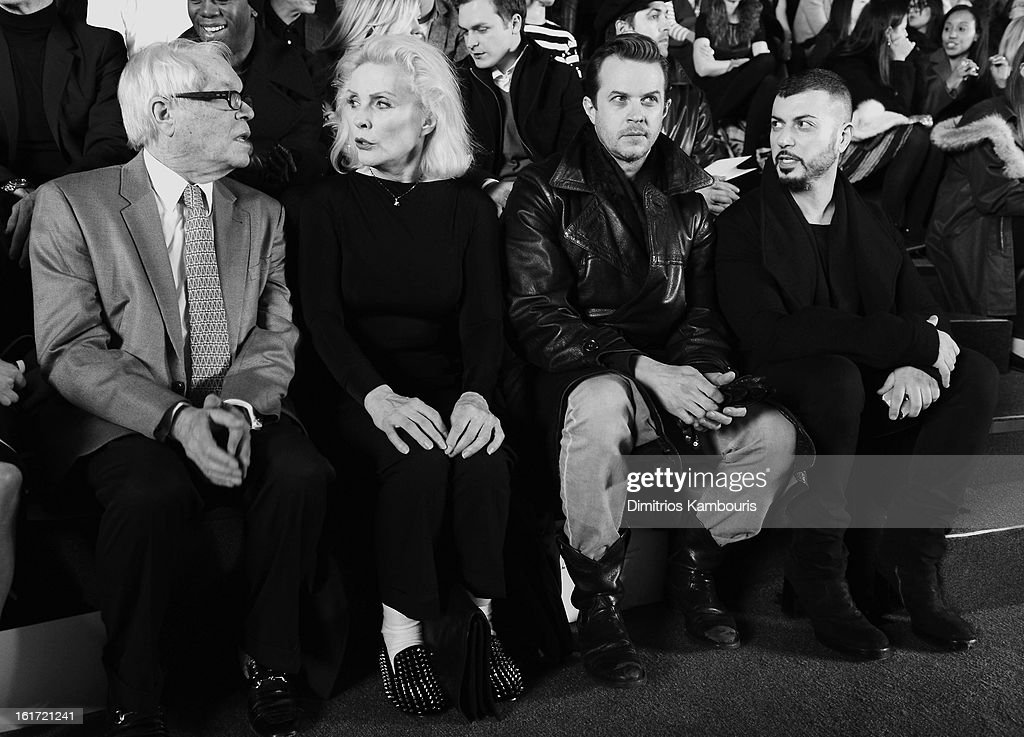 Deborah Harry (2nd from L) and Casey Spooner (2nd R) attend the Marc Jacobs Collection Fall 2013 fashion show during Mercedes-Benz Fashion Week at New York Armory on February 14, 2013 in New York City.