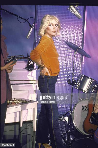 Deborah Harry lead singer of new wave group Blondie wearing Gloria Vanderbilt's Murjani jeans while making commercial for jeans