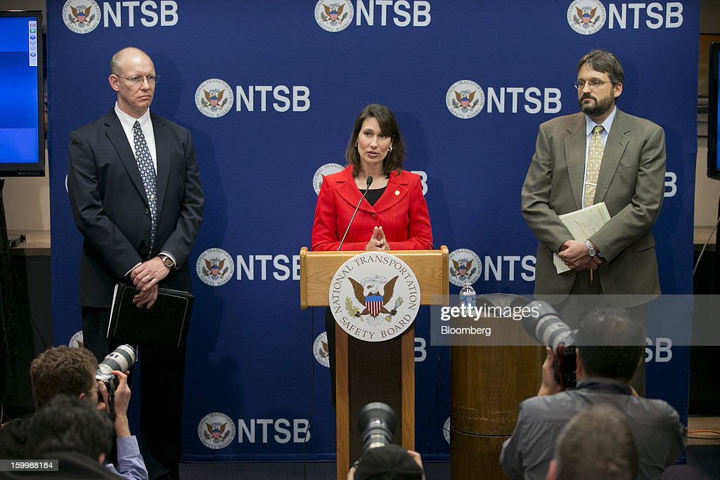 Deborah Hersman, chairman of the National Transportation Safety Board (NTSB), center, speaks during a news conference with John DeLisi, director of aviation safety with the NTSB, left, and Joseph Kolly, director of research and engineering with the NTSB, in Washington, D.C., U.S., on Thursday, Jan. 24, 2013. The design of Boeing Co.'s Dreamliner should have prevented battery incidents that prompted regulators to ground the plane on Jan. 7, Hersman said. Photographer: Andrew Harrer/Bloomberg via Getty Images