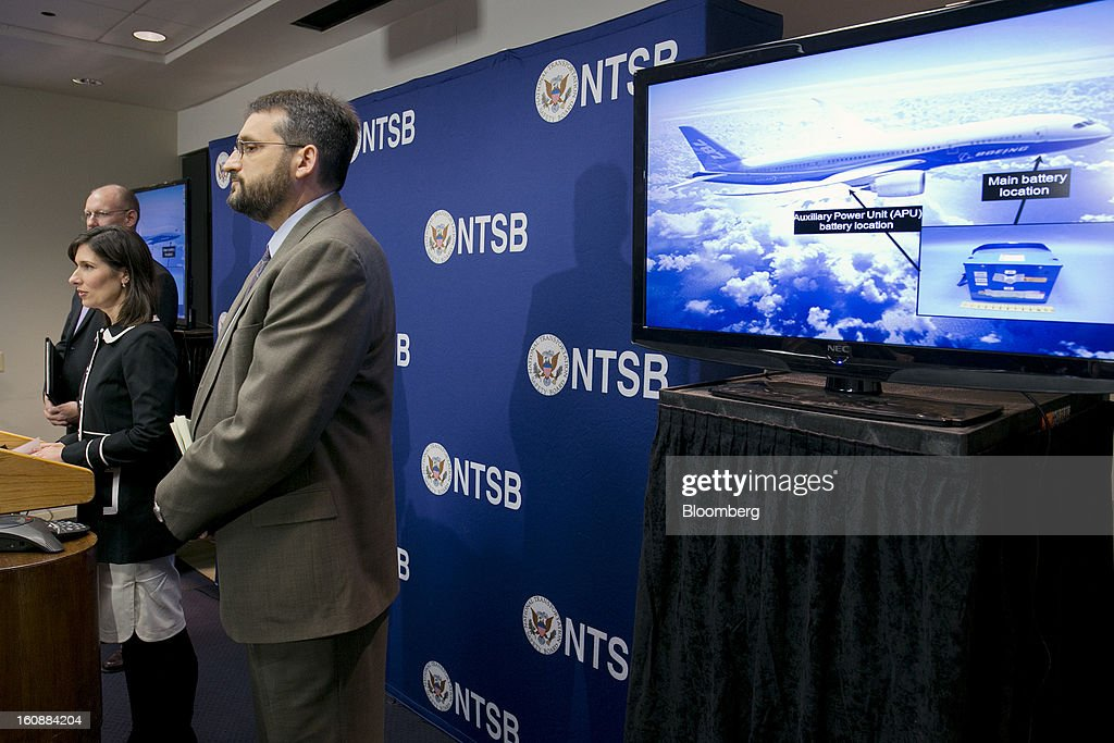 Deborah Hersman, chairman of the National Transportation Safety Board (NTSB), left, speaks during a news conference showing a Boeing Co. 787 Dreamliner on a television with Joseph Kolly, director of research and engineering with the NTSB, right, and John DeLisi, director of aviation safety with the NTSB, in Washington, D.C., U.S., on Thursday, Feb. 7, 2013. The top U.S. transportation safety investigator today questioned the adequacy of tests that prompted U.S. regulators to allow Boeing Co. to use lithium-ion batteries on the now-grounded 787 Dreamliner. Photographer: Andrew Harrer/Bloomberg via Getty Images