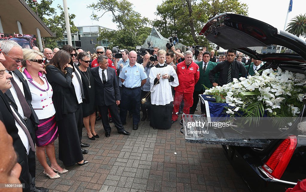 Deborah Holmes, Millie Elder-Holmes, Reuben Holmes and family farewell Sir Paul Holmes as the hearse drives away at Auckland Cathedral of the Holy Trinity in Parnell on February 8, 2013 in Auckland, New Zealand. Hundreds gathered to pay their respects to Sir Paul Homes who passed away last Friday after losing his battle with prostate cancer. Holmes' broadcasting career spanned over 40 years on radio and television in New Zealand, Australia, Netherlands and the UK.