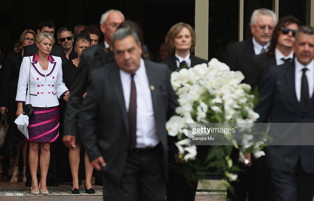 Deborah Holmes, wife of Sir Paul Holmes (L) follows the casket out of the service at Auckland Cathedral of the Holy Trinity in Parnell on February 8, 2013 in Auckland, New Zealand. Hundreds gathered to pay their respects to Sir Paul Homes who passed away last Friday after losing his battle with prostate cancer. Holmes' broadcasting career spanned over 40 years on radio and television in New Zealand, Australia, Netherlands and the UK.