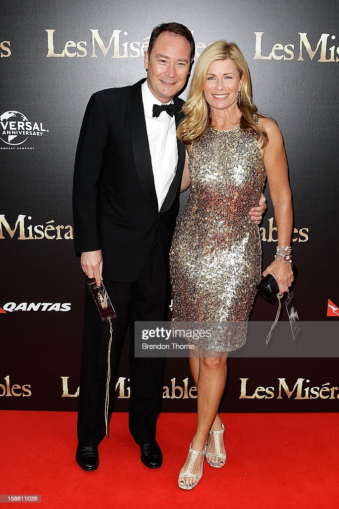 Deborah Hutton and guest walk the red carpet during the Australian premiere of 'Les Miserables' at the State Theatre on December 21, 2012 in Sydney, Australia.