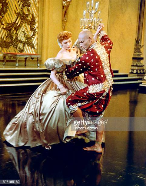 Deborah Kerr and Yul Brynner dance together in a classic scene from the film The King and I