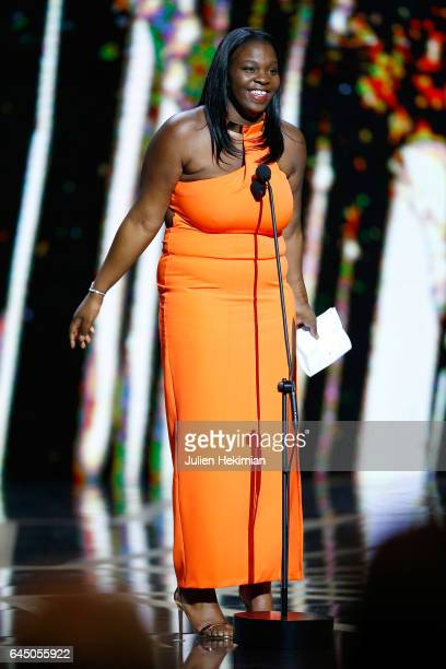 Deborah Lukumuena speaks on stage after she receives the Cesar of Best supporting actress in 'Divines' during the Cesar Film Awards Ceremony at Salle...