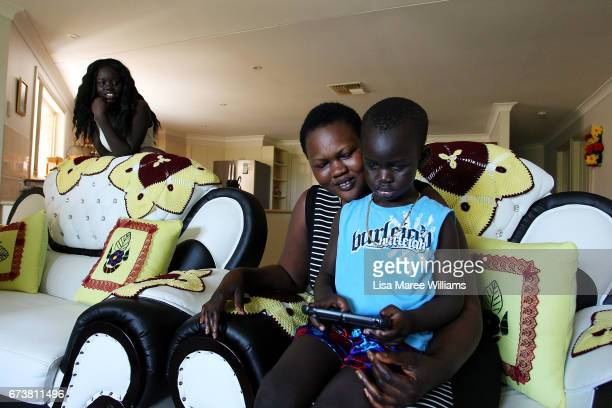 Deborah Manyang and son Thon look at a digital notebook on January 30 2017 in Tamworth Australia Tamworth is a large regional city in the New England...