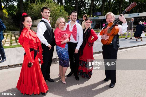 Deborah Meaden poses with traditional Spanish flamenco dancers accompanied by Spanish guitar perform at the RHS Chelsea Flower Show on May 22 2017 in...