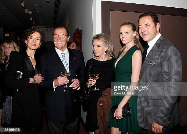 Deborah Moore Sir Roger Moore Christina Tholstrup Lara Stone and David Walliams attend '50 Years Of James Bond The Auction' celebrating the 50th...
