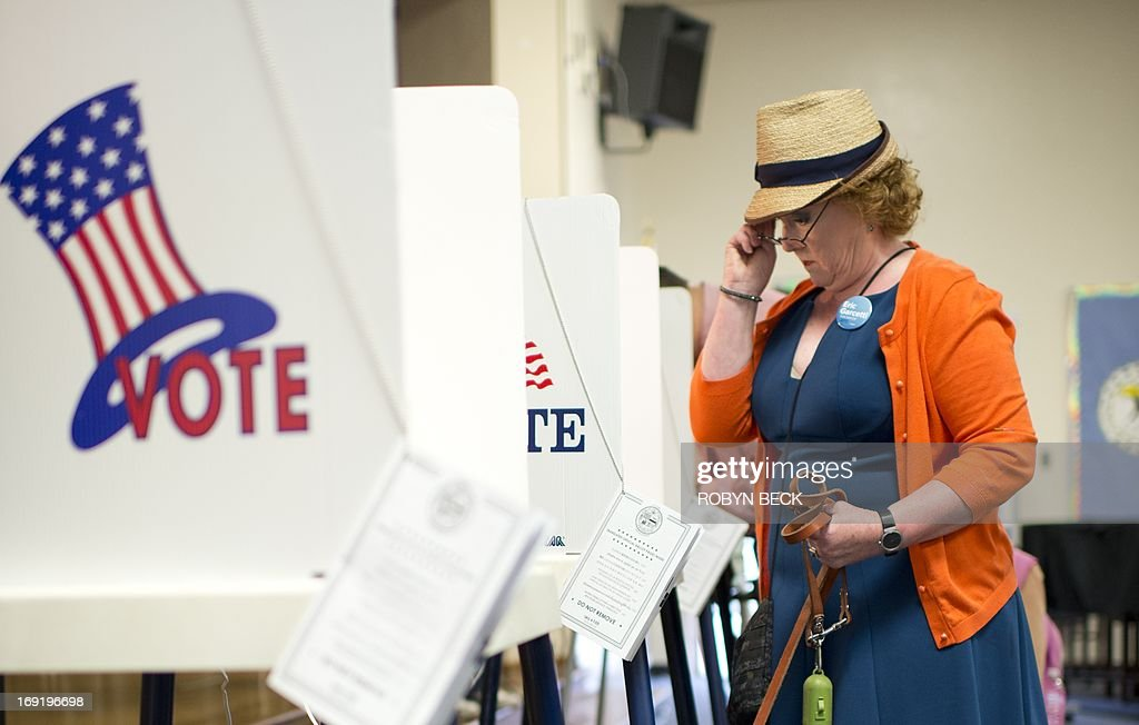 Deborah Murphy examines the ballot while voting at a polling station in Los Angeles on May 21, 2013. Los Angeles City Controller Wendy Greuel and Councilman Eric Garcetti are vying to replace Antonio Villaraigosa as the next mayor of Los Angeles.
