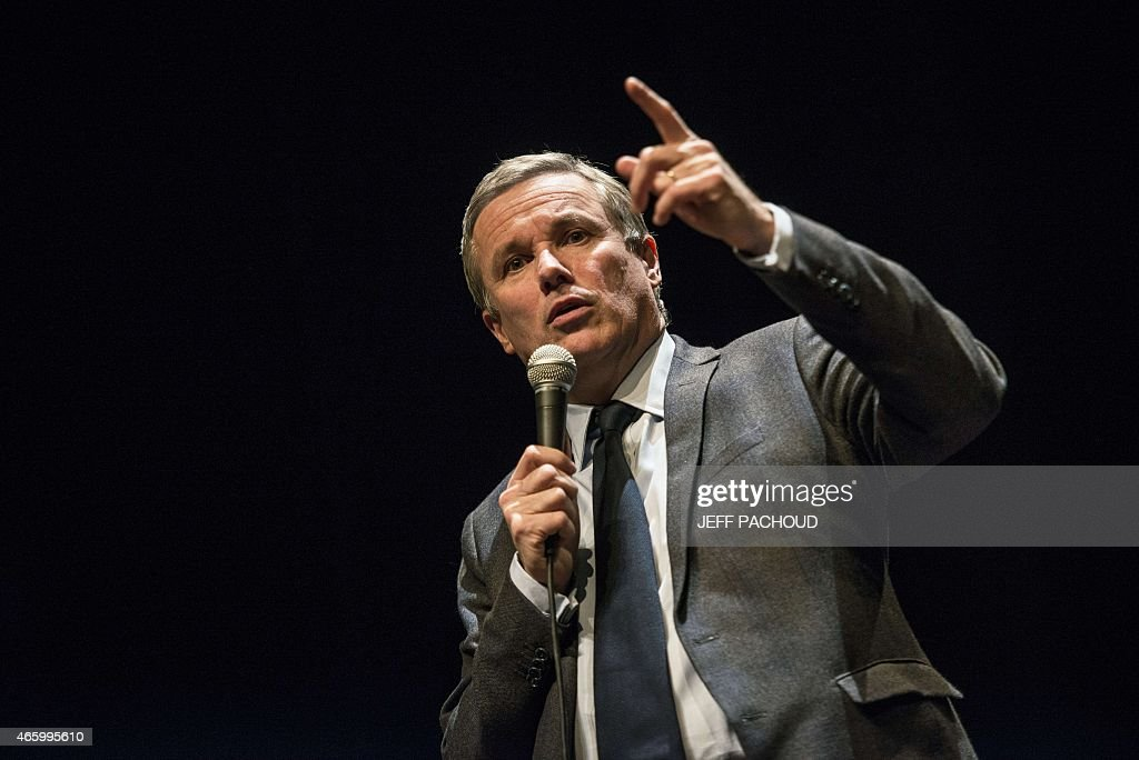 Debout la Republique (Stand up, the Republic ) party leader Nicolas Dupont-Aignan delivers a speech, on March 12, 2015 in Lyon, during a public meeting ahead of French departementales (Local) elections on March 12, 2015. AFP PHOTO / JEFF PACHOUD