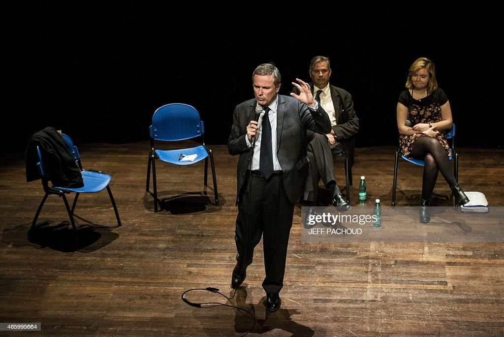 Debout la Republique (Stand up, the Republic ) party leader Nicolas Dupont-Aignan delivers a speech, on March 12, 2015 in Lyon, central eastern France, during a public meeting ahead of French departementales (Local) elections on March 12, 2015. AFP PHOTO / JEFF PACHOUD