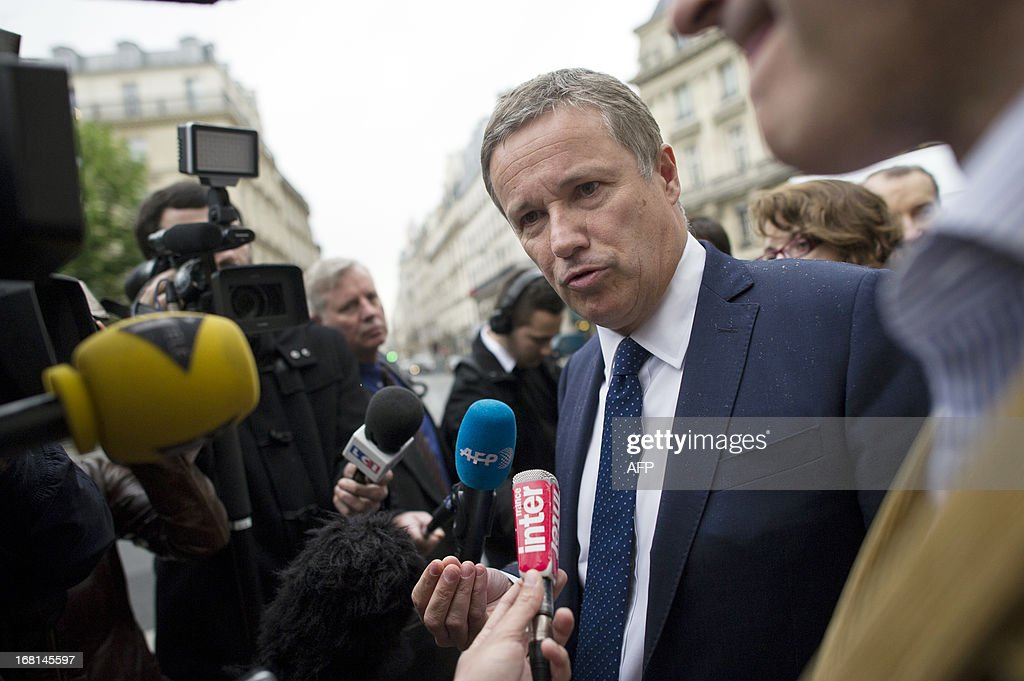 Debout La Republique party's president and French deputy Nicolas Dupont-Aignan talks to journalists as he arrives at the Elysée palace to offer a pair of glasses to the French President, to see the 'suffering of French people', on May 6, 2013 in Paris. AFP PHOTO / FRED DUFOUR