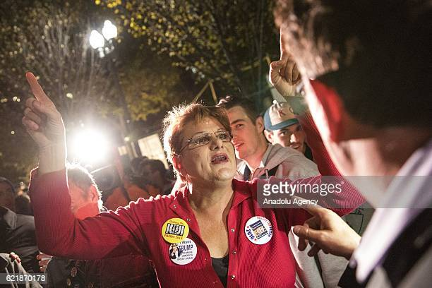 Debra Dangelo a Donald Trump supporter argues with Clinton supporters in a large crowd that gathered in front of the White House as the 2016...