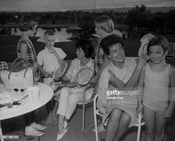Debra Derek and Cheryl Coughenour join their mother Mrs John F Coughenour at pool as Mrs Philip Sheridan gives assist to daughter Sally right Credit...