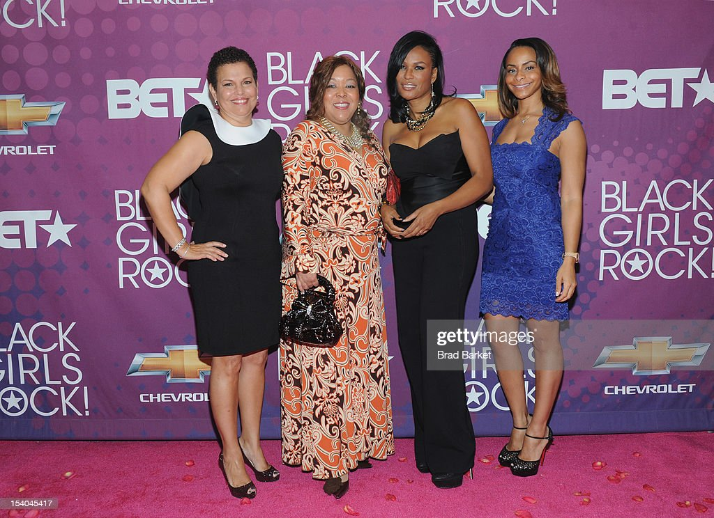Debra Lee (L) and Black Girls Rock! Founder Beverly Bond (2nd R) pose on a red carpet with guests during the CHEVY Shot Caller's Dinner at Espace NYC on October 12, 2012 in New York City.