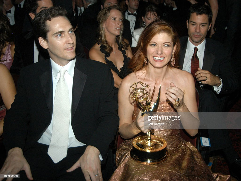 Debra Messing and husband Daniel Zelman during 55th Annual Primetime Emmy Awards - Backstage and Audience at The Shrine Auditorium in Los Angeles, California, United States.
