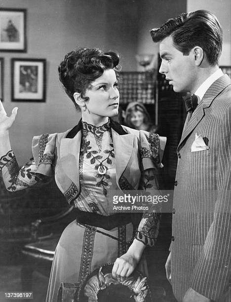 Debra Paget about to smack Robert Wagner in a scene from the film 'Stars And Stripes Forever' 1952