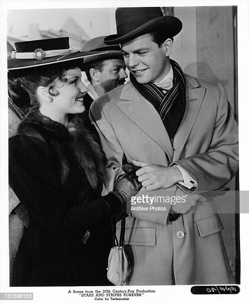 Debra Paget and Robert Wagner arm in arm in a scene from the film 'Stars And Stripes Forever' 1952