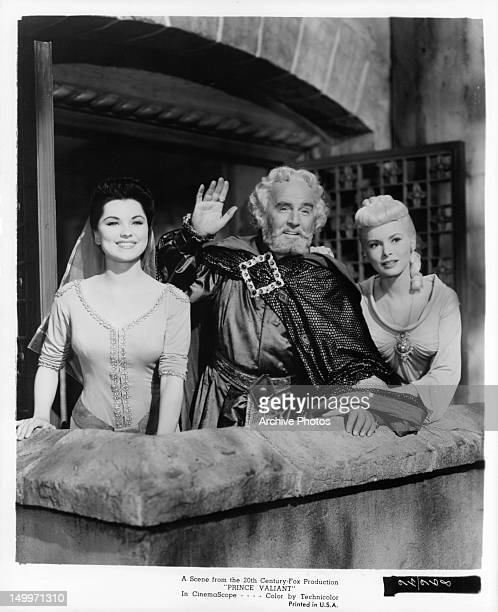 Debra Paget Barry Jones and Janet Leigh out on balcony in a scene from the film 'Prince Valiant' 1954