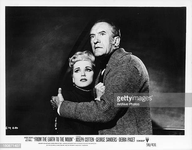 Debra Paget is held by George Sanders in a scene from the film 'From The Earth To The Moon' 1958