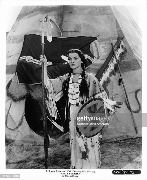 Debra Paget standing in front of teepee in a scene from the film 'White Feather' 1955