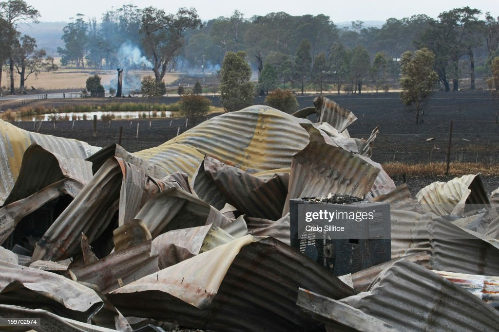 Debris after a fire in the town of Seaton is seen on January 19, 2013 in Melbourne, Australia. Bushfires in Victoria have claimed one life and destroyed several houses. Record heat continues to create extreme fire conditions throughout Australia.
