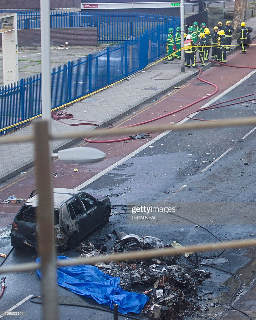 Debris and a burned out car are pictured at the scene of a helicopter in central London, on January 16, 2013. Two people were killed when a helicopter hit a crane at a building site in central London and plunged to the ground on Wednesday, police said.