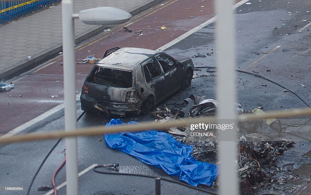 Debris and a burned out car are pictured at the scene of a helicopter crash in central London, on January 16, 2013. Two people were killed when a helicopter hit a crane at a building site in central London and plunged to the ground on Wednesday, police said.