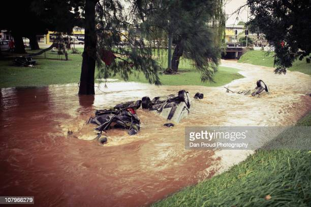 Debris and overturned cars are seen in central Toowoomba between 1500 and 1700 hours AEST following a flash flood which ripped through the town...