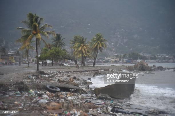 TOPSHOT Debris and trash is seen on a beach in CapHaitien on September 7 as Hurricane Irma approaches Irma was packing maximum sustained winds of up...