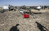 Debris belonging to the A321 Russian airliner are seen at the site of the crash in Wadi alZolomat a mountainous area in Egypt's Sinai Peninsula on...