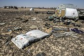 Debris belonging to the A321 Russian airliner areseen at the site of the crash in Wadi alZolomat a mountainous area in Egypt's Sinai Peninsula on...