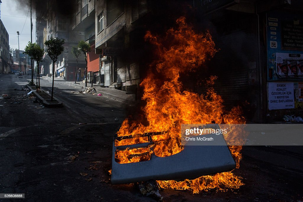 Debris burns on a street after police dispersed protesters in the Okmeydani neighbourhood during a May Day demonstration on May 1, 2016 in Istanbul, Turkey. Turkish police used tear gas and water cannon to disperse protesters as they tried to make their way to Taksim Square.