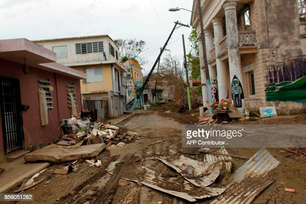 A debris covered street caused when the Arecibo River overflowed is seen in the aftermath of Hurricane Maria in Arecibo Puerto Rico September 30 2017...