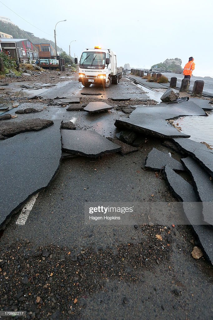 Debris covers The Esplanade in Owhiro Bay after a storm on June 21, 2013 in Wellington, New Zealand. Winds reached up to 200km per hour during the storm and around 30,000 homes were left without power across the Wellington region.
