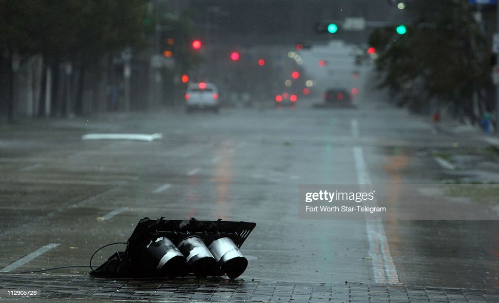Debris covers the streets in downtown Houston Texas in the aftermath of Hurricane Ike on Saturday September 13 2008