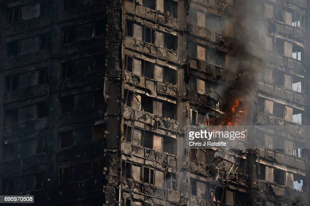 Debris falls from the burning 24 storey residential Grenfell Tower block in Latimer Road West London on June 14 2017 in London England The Mayor of...