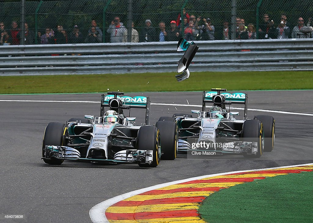 Debris flies in the air as <a gi-track='captionPersonalityLinkClicked' href=/galleries/search?phrase=Nico+Rosberg&family=editorial&specificpeople=800808 ng-click='$event.stopPropagation()'>Nico Rosberg</a> of Germany and Mercedes GP makes contact with <a gi-track='captionPersonalityLinkClicked' href=/galleries/search?phrase=Lewis+Hamilton+-+Racecar+Driver&family=editorial&specificpeople=586983 ng-click='$event.stopPropagation()'>Lewis Hamilton</a> of Great Britain and Mercedes GP during the Belgian Grand Prix at Circuit de Spa-Francorchamps on August 24, 2014 in Spa, Belgium.