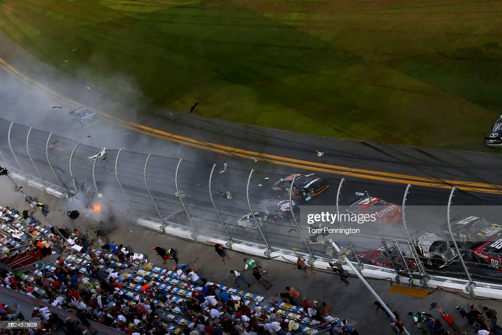 Debris flies into the stands following an incident at the finish of the NASCAR Nationwide Series DRIVE4COPD 300 at Daytona International Speedway on February 23, 2013 in Daytona Beach, Florida.