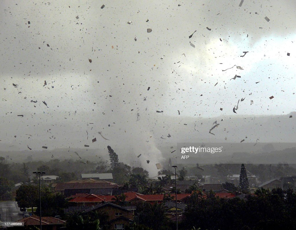 Debris flies through the air as a freak tornado tears through the coastal town of Lennox Head on June 3 2010 The storm levelled 12 homes and damaged...