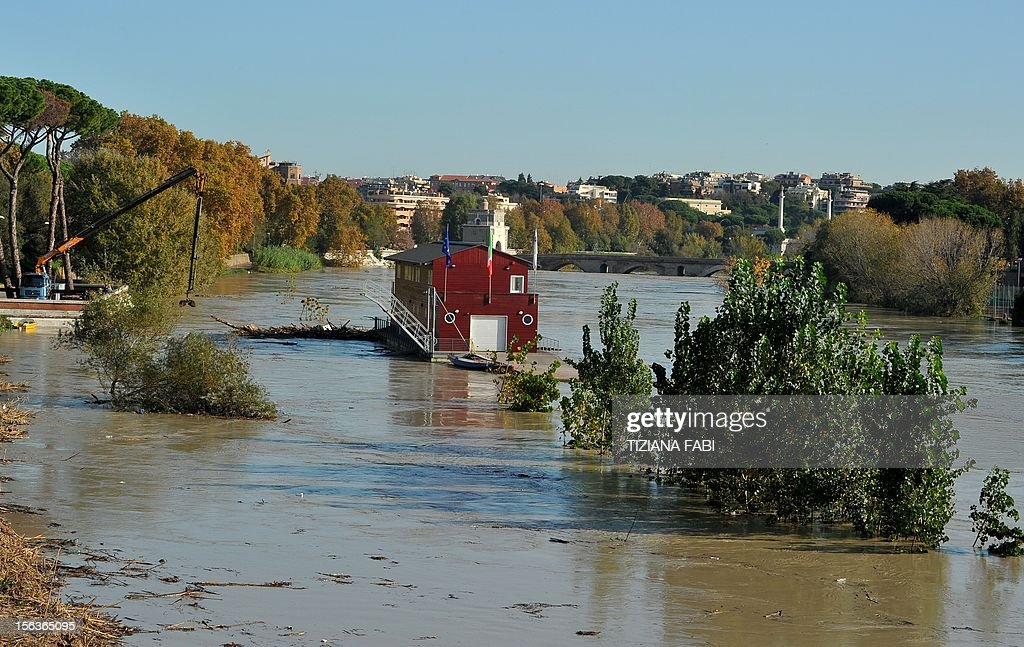 Debris float in the Tiber river as its level is rising on November 14, 2012 in Rome. Flooding struck the northern outskirts of Rome on Wednesday after heavy rains in central Italy swelled the Tiber River, as Tuscany, Umbria and Venice counted the costs of extensive flood damage.