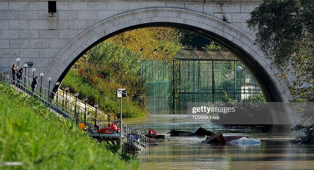 Debris float in the Tiber river as its level is rising on November 14, 2012 in Rome. Flooding struck the northern outskirts of Rome on Wednesday after heavy rains in central Italy swelled the Tiber River, as Tuscany, Umbria and Venice counted the costs of extensive flood damage. AFP PHOTO / TIZIANA FABI