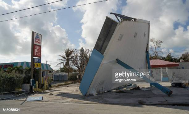 Debris from a damaged business sits on the side of the road on US1 on September 16 2017 in Marathon Florida Many places in the Keys still lack water...