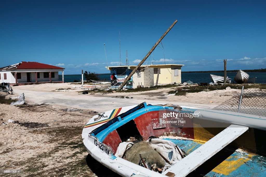 Debris from damaged homes lines a street on the nearly destroyed island of Barbuda on December 8, 2017 in Cordington, Barbuda. Barbuda, which covers only 62 square miles, was nearly leveled when Hurricane Irma made landfall with 185mph winds on the night of September six. Only two days later, fearing Barbuda would be hit again by Hurricane Jose, the prime minister ordered an evacuation of all 1,800 residents of the island. Most are now still in shelters scattered around Barbuda's much larger sister island Antigua.